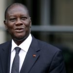 Ivory Coast's president Alassane Ouattara poses before a meeting with French Economy minister marking the 40th anniversary of the France zone, on October 5, 2012 in Paris.  AFP PHOTO KENZO TRIBOUILLARD